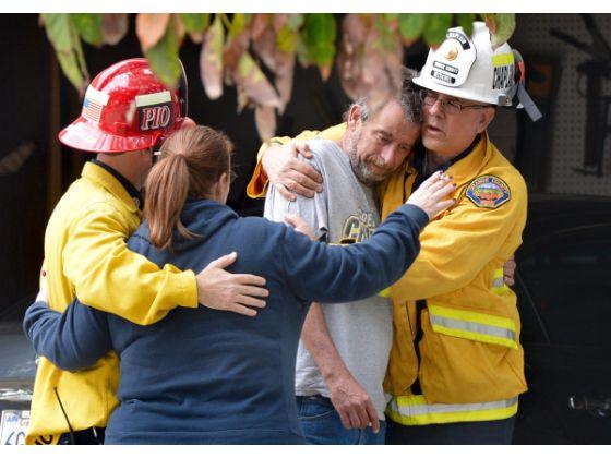 Comforting fire survivor